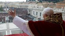 "In this photo provided by Vatican paper L'Osservatore Romano, Pope Benedict XVI delivers his ""Urbi et Orbi"" (to the City and to the World) message from the central balcony of St. Peter's Basilica, at the Vatican, Tuesday, Dec. 25, 2012. (Gregorio Borgia/AP)"