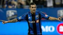 Montreal Impact's Andres Romero celebrates after scoring against Toronto FC during second half second leg semi-final Amway Canadian Championship soccer action in Montreal, Wednesday, May 1, 2013. (The Canadian Press)