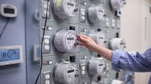 "Gary Murphy, Chief Project Officer for Smart Metering at BC Hydro, tests smart meter units which will be installed in homes around BC in the coming months in July 2011. Nearly half of Ontario's 77 electricity distributors have installed so-called ""smart"" meters manufactured by a U.S. company whose equipment has been linked to nine fires in Saskatchewan, Ontario's electricity regulator said Thursday. (Brett Beadle For The Globe and Mail)"