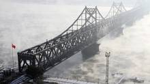 The Friendship Bridge, which connects the Chinese city of Dandong with Sinuiju in North Korea, is seen amid heavy fog over the Yalu River, in Dandong, Liaoning province December 16, 2010. (JACKY CHEN/REUTERS)