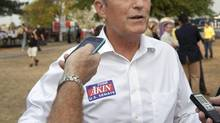"In this Thursday, Aug. 16, 2012 photograph, Rep. Todd Akin, R-Mo., talks with reporters while attending the Governor's Ham Breakfast at the Missouri State Fair in Sedalia, Mo. Akin was keeping a low profile, Monday, Aug. 20, 2012, a day after a TV interview in which he said that women's bodies can prevent pregnancies in ""a legitimate rape"" and that conception is rare in such cases. (Orlin Wagner/AP)"