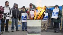 Lear Whitby workers picket outside the facility in Whitby Ontario on Sunday October 28, 2012. (Aaron Vincent Elkaim/THE CANADIAN PRESS)
