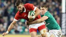 Canada's wing DTH Van Der Merwe is tackled by Ireland's centre Garry Ringrose during the rugby union test match between Ireland and Canada in Dublin on Nov. 12, 2016. (Paul Faith/AFP/Getty Images)