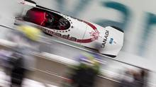 Pilot Kaillie Humphries (front) and brakeman Heather Moyse make their way down the bobsleigh in the women's heat three at the Whistler Sliding Centre February 24, 2010. (JOHN LEHMANN/THE GLOBE AND MAIL)