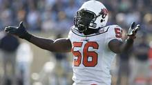 B.C. Lions' Solomon Elimimian (56) gestures to the crowd after they booed a late hit on Winnipeg Blue Bombers' Brock Ralph (80) during the first half of their CFL game in Winnipeg Monday, October 11, 2010. (The Canadian Press)