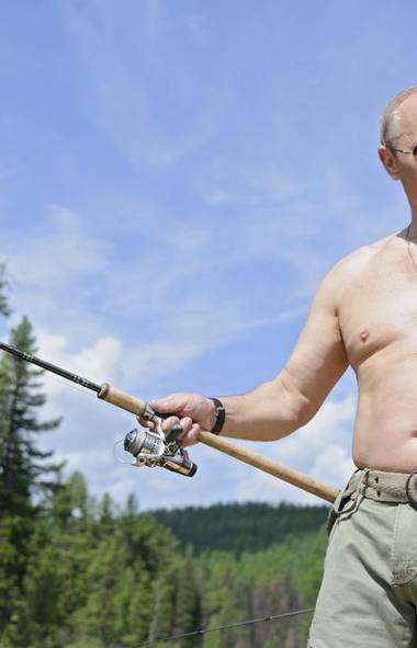 """Homosexuals must be this tall to play in the Olympics,"" Vladimir Putin announces in his Moscow office after continuing to shave his chest into his 60s. (RIA Novosti/Reuters)"
