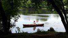Professor Root Gorelick makes nature part of his everyday life, paddling his canoe to work along Ottawa's Rideau River. (Dave Chan For The Globe and Mail)