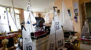Bill Shorney works on one of his 32 radio-controlled sail boats in preparation for an upcoming regatta.