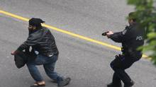 Vancouver police use a stun gun to subdue a man in 2011. (Florian Schaefer For The Globe and Mail)