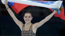 Adelina Sotnikova of Russia celebrates winning the women's figure skating gold in Sochi. (Ivan Sekretarev/Associated Press)