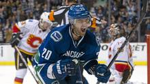 Chris Higgins of the Vancouver Canucks celebrates after scoring during the second period against the Calgary Flames on Dec. 4, 2011. (Rich Lam/Getty Images/Rich Lam/Getty Images)