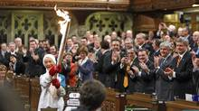 Former Olympian Barbara Ann Scott carries the torch in the House of Commons on December 10, 2009. (CHRIS WATTIE)