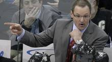 """Pittsburgh Penguins coach Dan Bylsma talks with referee Tim Peel during the second period of an NHL hockey game against the Philadelphia Flyers in Pittsburgh on Tuesday, Dec. 15, 2009. Bylsma has learned one important lesson about the chase for the Stanley Cup.""""You can do everything right and that doesn't mean you're going to win,"""" the Pittsburgh Penguins coach said Wednesday. (Gene J. Puskar/AP)"""