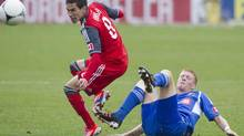 Toronto FC 's Eric Avila (left) is tackled during second half MLS action in Toronto on Saturday October 20, 2012. (Chris Young/THE CANADIAN PRESS)