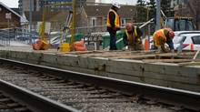 Toronto Transit Commission (TTC) construction workers extend the platform of the Agincourt GO Transit station as part of the Sheppard East Light Rail Transit (LRT) project in Toronto, Thursday, December 2, 2010. (Adrien Veczan/Adrien Veczan for the Globe and Mail)