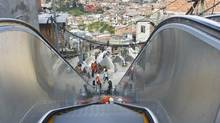 Technicians work on a public escalator at Commune 13 in Medellin December 28, 2011. The decision to spend the biggest portion of municipal budget on infrastructure and services in the poorest parts of Medellin is helping transform this Colombian city. (FREDY BUILES/REUTERS)