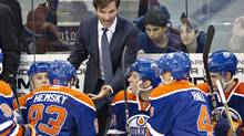 Edmonton Oilers head coach Dallas Eakins talks to his players while playing the New York Rangers during third period NHL preseason hockey action in Edmonton, Alta., on Tuesday September 24, 2013. (JASON FRANSON/THE CANADIAN PRESS)