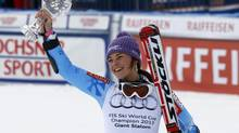 Slovenia's Tina Maze shows the crystal globe trophy of the women's alpine skiing giant slalom at the World Cup finals in Lenzerheide, Switzerland, Sunday, March 17, 2013. (ALESSANDRO TROVATI/AP)