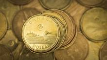The loonie broke through the 77-cent (U.S.) mark on Thursday, extending a streak as one of the hottest currencies in the world since bottoming out in the depths of the winter sell-off. (Mark Blinch/Reuters)