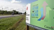 A government Economic Action Plan sign sits by a roadside near Mississippi Mills, Ont., in August 2010. (Adrian Wyld/Adrian Wyld/The Canadian Press)