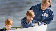 Diana, Princess of Wales, enjoys a ride on the Maid of Mist in Niagara Falls, Ont., in this Oct., 1991, file photo, with her sons Prince Harry, then 7, and Prince William, then 9. (Hans Deryk/The Canadian Press/Hans Deryk/The Canadian Press)