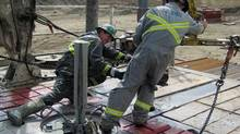 Workers on an oil rig in southern Saskatchewan last summer. In the past two years, both payroll employment and average weekly earnings in the province have seen higher-than-average growth. (Gord Pitts/Gordon Pitts/The Globe and Mail)