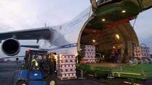 A shipment of Beaujolais Nouveau wine is loaded into an Antonov cargo plane, Nov. 13, 2002, at Lyon's Saint Exupery airport, central France. (PATRICK GARDIN/Associated Press)