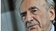 In this Dec. 10, 2009 file photo, Holocaust survivor and Nobel Peace Prize winning author Elie Wiesel listens during an interview with The Associated Press in Budapest, Hungary. (Bela Szandelszky/Associated Press)