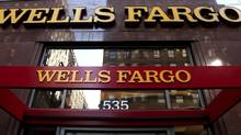 A Wells Fargo sign is displayed at a branch in New York. (CX Matiash/AP)