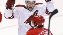 Phoenix Coyotes winger Wojtek Wolski of Poland celebrates his goal in front of Detroit Red Wings winger Henrik Zetterberg during the second period in a first-round NHL playoff game in Detroit, Sunday, April 25, 2010. (Carlos Osorio/AP)