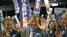 Conservative candidate Maxime Bernier acknowledges applause during a Quebec City election rally on October 12, 2008. (Reuters)