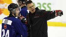 Head coach Dave Cameron (right) talks to Brad Ross (centre) during the tryouts held in Toronto on Sunday for the Canadian team that will compete in the 2011 IIHF World Junior Championship. (MIKE CASSESE/The Canadian Press)