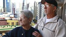 Rene Beaudoin (R) holds his wife Lilliane Beaudoin, as they look out over downtown Vancouver from their hotel October 14, 2011. Lilliane Beaudoin's adopted sister Dianne Rock is one of convicted serial murderer Robert Pickton's victims. (Jeff Vinnick for The Globe and Mail/Jeff Vinnick for The Globe and Mail)