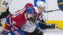 Montreal Canadiens' Paul Byron (41) tries to hold back Pittsburgh Penguins' Sidney Crosby during first period NHL hockey action Saturday, January 9, 2016 in Montreal. (Paul Chiasson/THE CANADIAN PRESS)