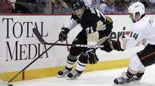 Pittsburgh Penguins' Evgeni Malkin (71) works the puck in the corner past Anaheim Ducks' Rod Pelley (14) in the second period of an NHL hockey game in Pittsburgh on Wednesday, Feb. 15, 2012. (Gene J. Puskar/AP)