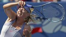 Maria Sharapova of Russia hits a return to Flavia Pennetta of Italy during their match at the U.S. Open tennis tournament in New York, September 2, 2011. (LUCY NICHOLSON/REUTERS)