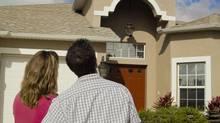 Potential home buyers looking at a house. (James Kurtz/Photos.com)