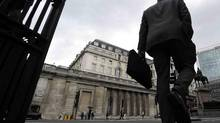 A man walks past the Bank of England, in the City of London June 15, 2012. (PAUL HACKETT/Reuters)