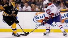Montreal Canadiens defenceman P.K. Subban, right, battles for the puck with Boston Bruins right winger Reilly Smith during the second period of game five of the second round of the 2014 Stanley Cup Playoffs at TD Banknorth Garden in Boston on May 10. (Greg M. Cooper/USA Today Sports)