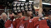 McGill Redmen team captain Evan Vossen kisses the University Cup after his team beat the Western Mustangs to win the 2012 CIS men's ice hockey championship on Sunday, March 25, 2012 in Fredericton, New Brunswick. McGill won the game 4-3 in OT, with Vossen scoring the game winner. THE CANADIAN PRESS/Mike Dembeck. (Mike Dembeck/CP)