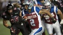 Montreal Alouettes running back Brandon Whitaker runs with the ball asthey face the Ottawa Redblacks during first quarter CFL football action (PAUL CHIASSON/THE CANADIAN PRESS)