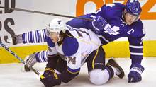Maple Leafs captain Dion Phaneuf, battling Blues forward T.J. Oshie, is Toronto's top minute-eating defenceman. (Mark Blinch For The Globe and Mail)