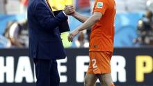 Netherlands' head coach Louis van Gaal shakes hands with Ron Vlaar during the group B World Cup soccer match between the Netherlands and Chile at the Itaquerao Stadium in Sao Paulo, Brazil, Monday, June 23, 2014. (Kirsty Wigglesworth/AP)
