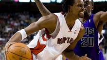 Toronto Raptors forward Chris Bosh, left, drives against Sacramento Kings defender Donte Greene during the first half of their NBA basketball game in Toronto, February 7, 2010. (STRINGER/CANADA)