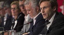New Brunswick Premier Brian Gallant, right, fields a question at the closing news conference of the summer meeting of Canada's premiers in St. John's on Friday, July 17, 2015. THE CANADIAN PRESS/Andrew Vaughan (Andrew Vaughan/THE CANADIAN PRESS)