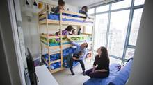 Adrian Crook, Sarah Zaharia and Crook's five children: 8, 7, 6, 5, and 3-years-old. 'I'm not going to live in a six- or seven-bedroom house in my lifetime. And I don't even want it.' (Ben Nelms/The Globe and Mail)