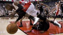Toronto Raptors guard Terrence Ross tumbles over Brooklyn Nets player Paul Pierce during Game 5 of their first-round NBA playoff series Wednesday night in Toronto. (Frank Gunn/THE CANADIAN PRESS)