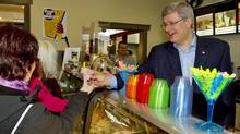Conservative Leader Stephen Harper serves gelato in Riviere du Loup, Que, on April 20, 2011. (Frank Gunn/THE CANADIAN PRESS)