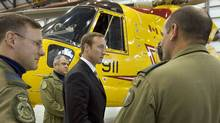 Defence Minister Peter MacKay speaks with search-and-rescue personnel in front of a CH-149 Cormorant helicopter in Halifax on Sept. 12, 2007. (Andrew Vaughan/The Canadian Press)