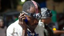 A man tries to talk on his cellphone Jan. 12 in Port-au-Prince, the day a major earthquake rocked Haiti. (Frederic Dupoux/2010 Getty Images)